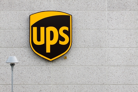 Vejle, Denmark - July 4, 2015: UPS United Parcel Service logo on a facade. United Parcel Service is the worlds largest package delivery company and a provider of supply chain management solutions. Editorial