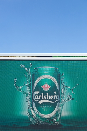 carlsberg: Aarhus, Denmark - August 12, 2015: Carlsberg logo on a truck. The Carlsberg Group is a danish brewing company founded in 1847 by J. C. Jacobsen with headquarters located in Copenhagen, Denmark