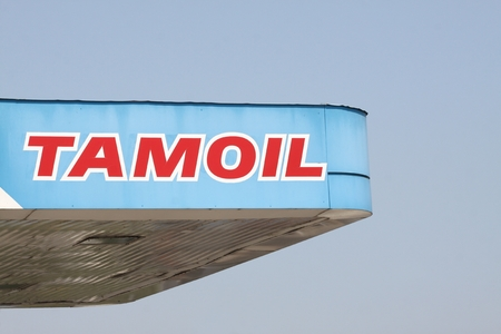 fuel provider: Milan, Italy - July 22, 2015: Tamoil logo on a gas station. Tamoil is the trading name of the Oilinvest Group, a fuel energy provider within the European downstream oil and gas sector.