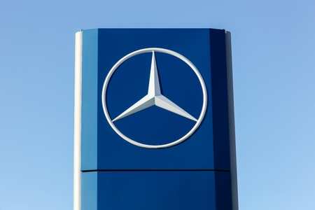 daimler: Aarhus, Denmark - August 8, 2015: Mercedes logo on a facade. Mercedes-Benz is a german automobile manufacturer, a multinational division of the german manufacturer Daimler AG. Mercedes-Benz is a german automobile manufacturer, a multinational division o