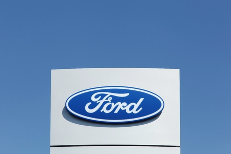 automaker: Aarhus, Denmark - August 22, 2015: Ford logo. Ford is an American multinational automaker headquartered in Dearborn, Michigan, a suburb of Detroit. It was founded by Henry Ford and incorporated on June 16, 1903.