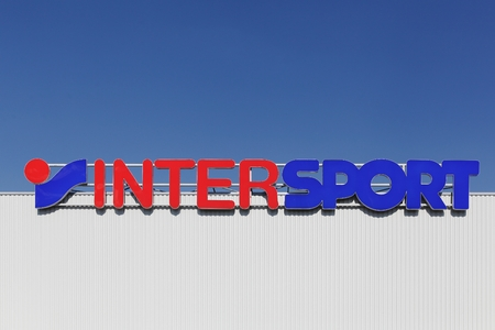 retailer: Villefranche sur Saone, France- May 22, 2015: Intersport logo on a faade. The Intersport Group is an international sporting goods retailer