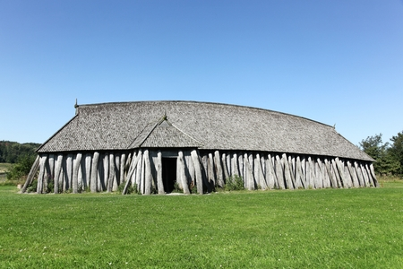 Hobro, Denmark - August 19, 2015: Viking house in the city of Hobro. This viking house reconstruction at the Fyrkat viking fortress in Hobro, Denmark, is a typical viking house design.