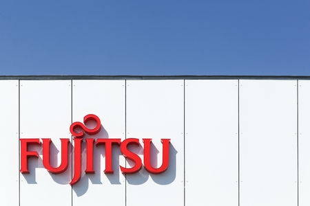 Aarhus, Denmark - August 22, 2015: Fujitsu logo on a facade. Fujitsu is a Japanese multinational information technology equipment and services company headquartered in Tokyo, Japan.