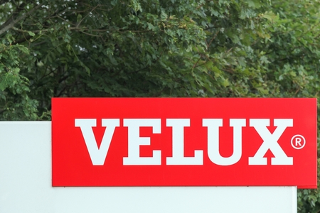 specializes: Ostbirk, Denmark - September 5, 2015: Velux logo at the entrance of a factory. Velux is a danish company that specializes in windows and skylights.