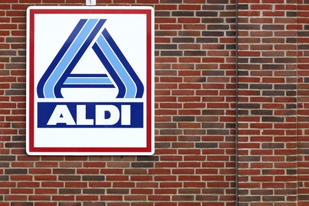 discounting: Skanderborg, Denmark - September 6, 2015: Aldi logo on a facade. Aldi is a leading global discount supermarket chain with over 9 000 stores in 18 countries