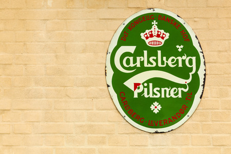 carlsberg: Viborg, Denmark - September 10, 2015: Old advertising of Carlsberg on a wall of a restaurant. Carlsberg Group is a danish brewing company founded in 1847 with headquarters located in Copenhagen.