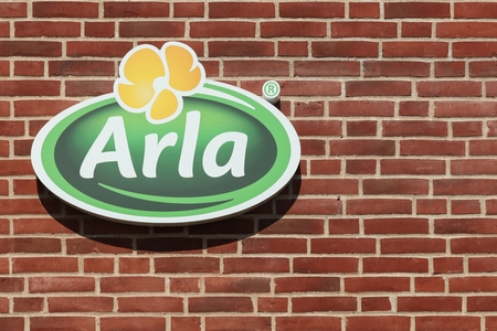 Aarhus, Denmark - August 22, 2015: Arla Foods  logo on a brick wall. Arla Foods is an international cooperative based in Aarhus, Denmark and the largest producer of dairy products in Scandinavia Editorial