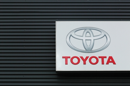 Skanderborg, Denmark - August 5, 2015: Toyota logo on a facade of a dealer. Toyota motor corporation is a japanese automotive manufacturer headquartered in Toyota, Aichi, Japan Editorial