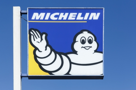 Lyon, France - September 21, 2015: Michelin logo on a pole. Michelin is a tire manufacturer based in Clermont-Ferrand in France and it is one of the three largest tire manufacturers in the world.