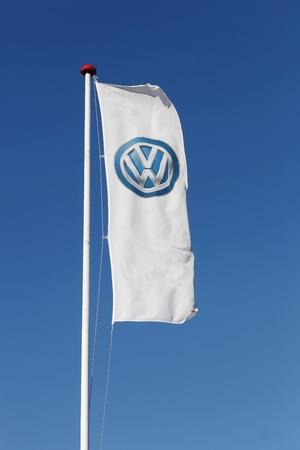 logo marketing: Horsens, Denmark - September 30, 2015: Volkswagen logo on a flag. Volkswagen is a german car manufacturer headquartered in Wolfsburg, Germany.