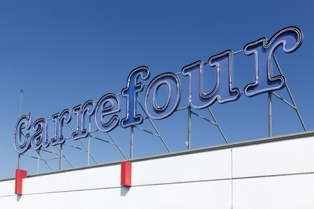 carrefour: Macon, France - September 21, 2015: Carrefour sign on a facade of a hypermarket.  Carrefour is a french multinational retailer headquartered in France and it is one of the largest hypermarket chains in the world