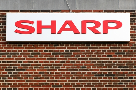 electronic: Aarhus, Denmark - October 15, 2015: Sharp logo on a facade. Sharp is a Japanese multinational corporation that designs and manufactures electronic products. Editorial