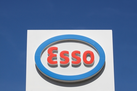 headquartered: Lyon, France - September 25, 2015: Esso is an international trade name for ExxonMobil and its related companies. Exxon Mobil Corp is an American multinational oil and gas corporation headquartered in Texas