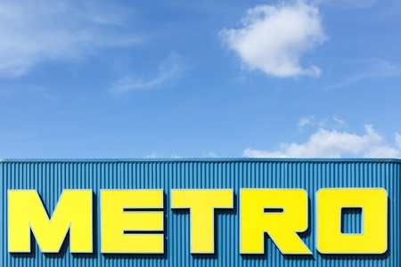 faade: Lyon, France - September 25, 2015: Metro logo on a faade of a supermarket. Metro  cash and carry is a leading international player in self service wholesale trade Editorial