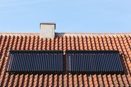 Solar glass tube hot water panel array on a roof