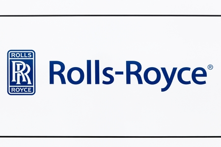 Hirtshals, Denmark - June 28, 2015: Rolls Royce logo on a wall. Rolls Royce is a British car manufacturing and aero engine manufacturing company