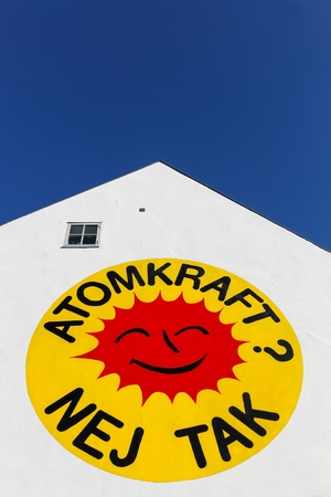 Aarhus, Denmark - October 25, 2015: Nuclear Power, No Thanks logo on a wall in Aarhus also known as the Smiling Sun,  is the international symbol of the anti-nuclear movement. Editorial