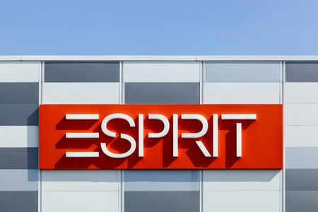 housewares: Macon, France - September 21, 2015:  Esprit logo on a facade. Esprit is a manufacturer of clothing, footwear, accessories, jewellery and housewares under the Esprit label.