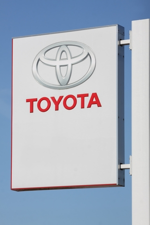 headquartered: Skanderborg, Denmark - August 9, 2015: Toyota sign on a pole. Toyota Motor Corporation is a Japanese automotive manufacturer headquartered in Toyota, Aichi, Japan