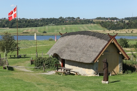 constitute: Hobro, Denmark - August 19, 2015: Viking Center Fyrkat consists of a viking farmstead, which is 9 reconstructed houses, that together constitute a large viking property