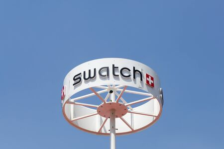 swiss insignia: Milan, Italy - July 21, 2015: Swatch Group designs, manufactures, distributes and sells finished watches, watch movements, prestige watch components, electronic systems and luxury jewelry