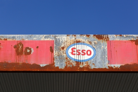 abandoned gas station: Aarhus, Denmark - October 28, 2015: Old and vintage logo of Esso on an abandoned gas station. Esso is an international gas trade name for ExxonMobil and its related companies. Editorial
