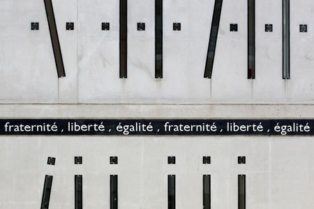 motto: Liberty, Equality, and Fraternity on a wall, the motto of the french revolution