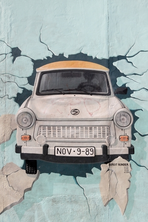 kinder: Berlin, Germany - September 9, 2014: Painting from Birgit Kinder of a Trabant in The East Side Gallery - Berlin Wall Editorial