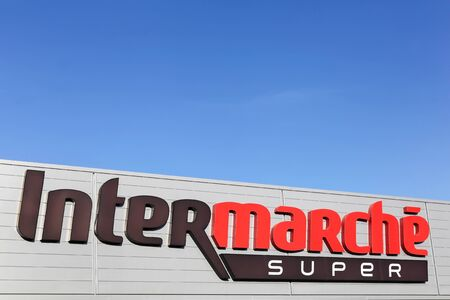 faade: Villefranche, France - January 24, 2016: Intermarche logo on a faade. Intermarche is the brand of a general commercial French supermarket, part of the large retail group Les Mousquetaires founded in 1969 Editorial