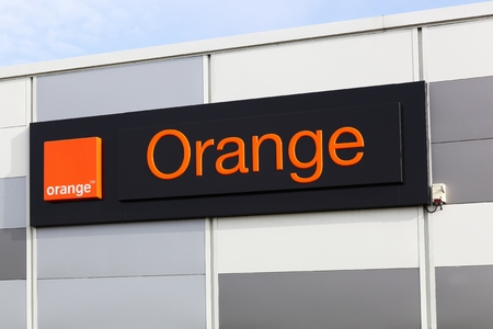 orange: Macon, France - January 30, 2016: Orange formerly France Telecom, is a French multinational telecommunications corporation. Orange has been the companys main brand for mobile, landline and internet