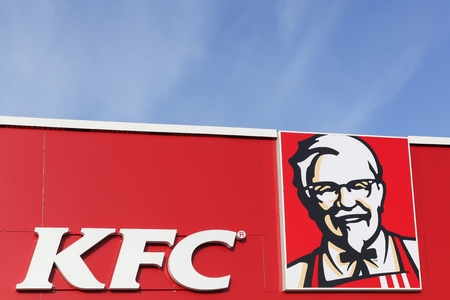 wordwide: Aarhus, Denmark - February 14, 2016: KFC logo on a facade. KFC is a fast food restaurant chain that specializes in fried chicken and is headquartered in Louisville, Kentucky, in the United States Editorial