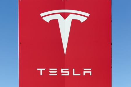 Aarhus, Denmark - February 13, 2016: Dealership sign of Tesla cars in Aarhus. Tesla is an American automotive and energy storage company that designs, manufactures, and sells luxury electric cars Redactioneel