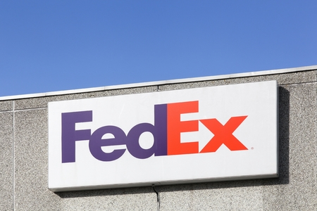 Kolding, Denmark - February 28, 2016: FedEx sign on a wall. FedEx Corporation is an American global courier delivery services company headquartered in Memphis, Tennessee