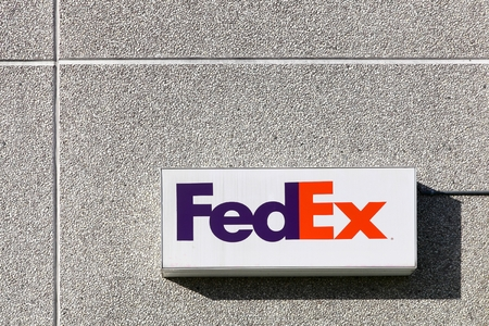 Kolding, Denmark - February 28, 2016: FedEx sign on a wall. FedEx Corporation is an American global courier delivery services company headquartered in Memphis, Tennessee Editorial
