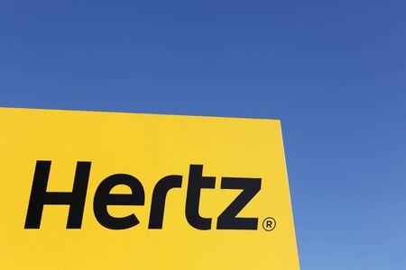 hertz: Aarhus, Denmark - February 13, 2016: Hertz logo on a panel. Hertz is an American car rental company with international locations in 145 countries worldwide Editorial