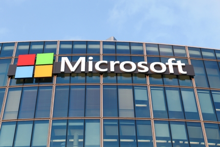 personal computers: Paris, France - March 28 2016: Microsoft is an American multinational technology company that develops, manufactures, licenses, supports and sells computer software, consumer electronics and personal computers and services
