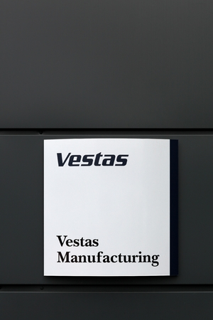 vestas: Randers, Denmark - March 13, 2016: Vestas logo in front of an office. Vestas Wind Systems is a danish manufacturer, seller, installer, and servicer of wind turbines. It is the largest in the world Editorial
