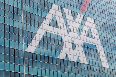 Milan, Italy - April 15, 2016: AXA office building in Milan. AXA is a French multinational insurance firm headquartered in Paris that engages in global insurance, investment management and financial services