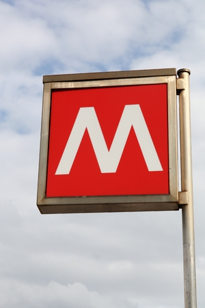 identified: Milan, Italy - April 15, 2016: Red metro sign in Milan, Italy. The Milan metro consists of 4 lines, identified by different numbers and colors. Editorial