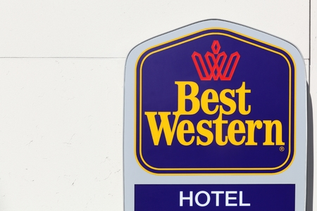 best travel destinations: Bergamo, Italy - April 15, 2016: Best Western logo on a wall. The Best Western Hotel brand operates about 4,100 hotels. The chain, with its corporate headquarters in Phoenix, Arizona Editorial