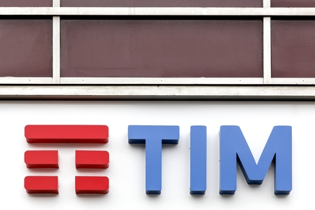 Milan, Italy - April 15, 2016: TIM logo on a wall. Telecom Italia Mobile, also known as TIM, is an Italian mobile phone network brand since 1995 Editorial