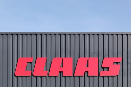 esbjerg: Esbjerg, Denmark - May 6, 2016: Claas logo on a wall. Claas is an agricultural machinery manufacturer founded in 1913, based in Germany
