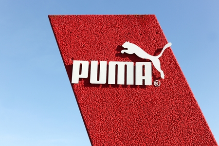 Skanderborg, Denmark - May 5, 2016: Puma logo on a wall. Puma is a major german multinational company that produces athletic and casual footwear, as well as sportswear, headquartered in Herzogenaurach in Germany Editorial