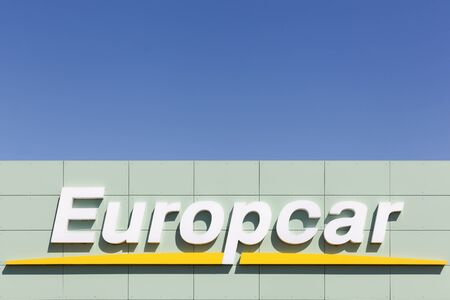 Aalborg, Denmark - May 9, 2016: Europcar logo on wall. Europcar is a French car rental company founded in 1949 in Paris Editorial