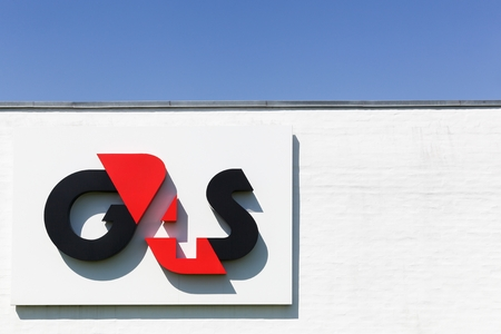 headquartered: Aalborg, Denmark - May 8, 2016: G4S logo on a wall. G4S is a British multinational security services company headquartered in central London and It is the worlds largest security company