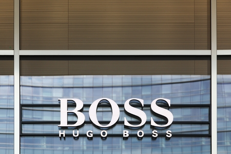 hugo: Milan, Italy - April 15, 2016: Hugo Boss sign on a store. Hugo Boss is a German luxury fashion house. It was founded in 1924 by Hugo Boss and is headquartered in Metzingen, Germany Editorial