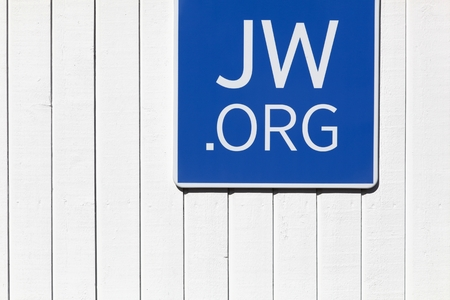 witnesses: Skejby, Denmark - May 16, 2016: Sign on a wall outside a Jehovahs witnesses kingdom hall.  Founded in the 1870s in the USA, the Jehovahs witnesses currently has over 8 million members Editorial
