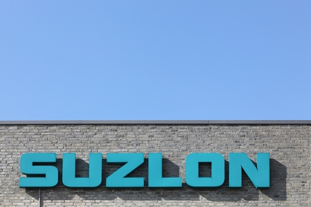 supplier: Skejby, Denmark - May 16, 2016: Suzlon logo on a wall. Suzlon Energy Limited, is a wind turbine supplier based in Pune, India. Formerly ranked as the worlds fifth largest supplier