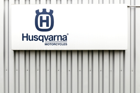 trimmers: Villefranche, France - March 20, 2016: Husqvarna  motorcycles logo on a facade.  Husqvarna is swedish a manufacturer of robotic mowers, garden tractors, chainsaws, trimmers, bicycles and motorcycles Editorial